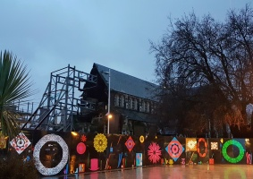 The Christchurch Cathedral behind a gaudy wall